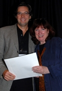 Jim receiving an award for a screenplay from Cynthia Whitcomb, President of Willamette Writers.